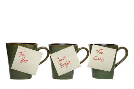 aussi: Trois tasses de notes: trop chaud, juste � droite, trop froid. Banque d'images