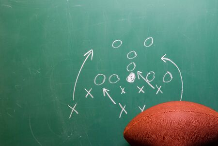 A coaches football play on a chalkboard. Banco de Imagens - 3896124