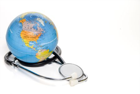 A globe of the Earth and a medical stethoscope. photo