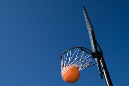 b ball: A basketball and goal waiting for a game to start. Stock Photo