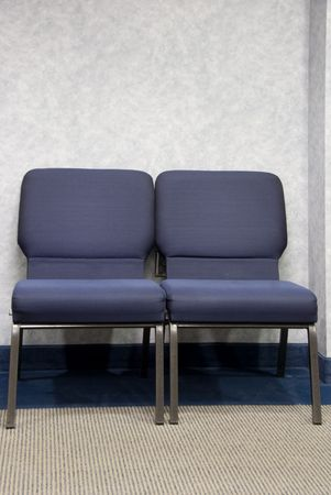 office furniture: Chairs in the waiting room of a doctors office. Stock Photo
