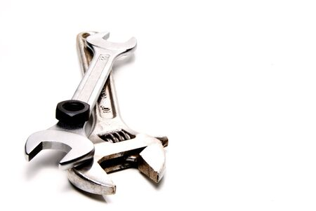 A couple of wrenches and a nut. Stock Photo - 3989490