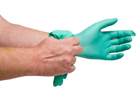 surgical glove: A worker putting on Latex Free Medical Gloves.