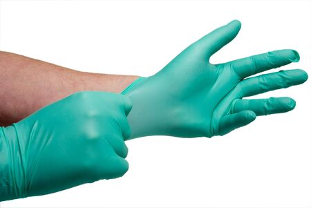 latex: A worker putting on Latex Free Medical Gloves.