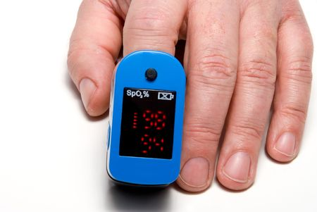 A pulse oximeter used to measure pulse rate and oxygen levels. Stock Photo