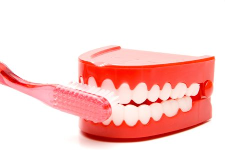 A toothbrush brushing a set of chattering teeth. photo