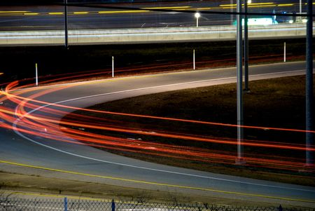 off ramp: The blur of tail lights on an on ramp.