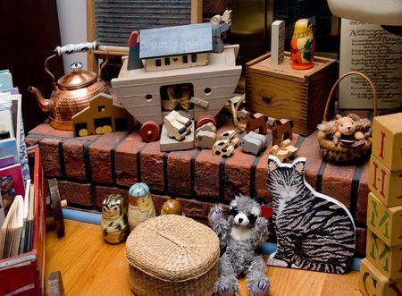 A collection of antique toys on a fireplace hearth. Stock Photo - 4135222