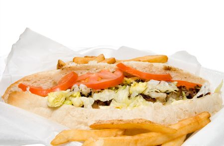 A Philly Cheesesteak and an oreder of French Fries photo