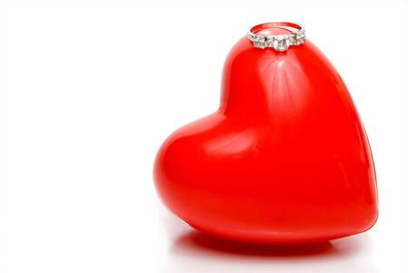 A diamond wedding ring on top of a red heart. Stock Photo - 4161282