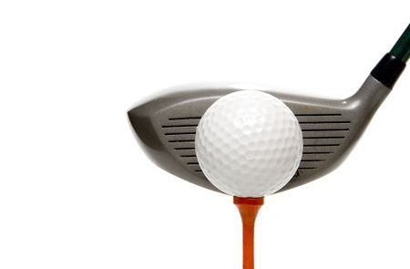 hits: A driver just before it hits a golf ball. Stock Photo
