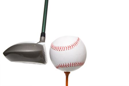 tee off: A driver before it hits a baseball on a golf tee.
