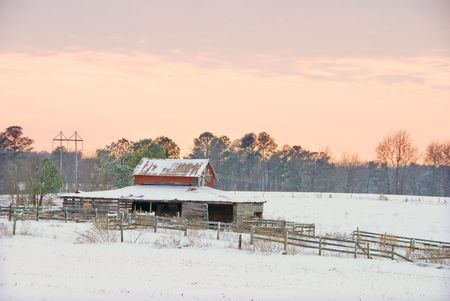 outbuilding: An old horse barn and corral in the snow. Stock Photo