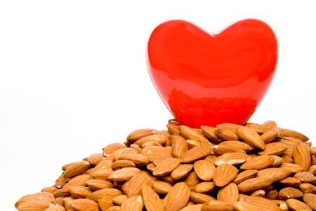 busting: A heart surrounded by cholesterol busting almonds.