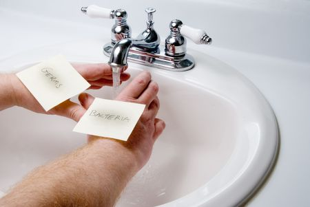 A person washing germs and bacteria off of theit hands. Stock Photo - 4306877