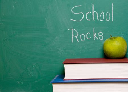 A chalkboard with the words School Rocks. Stock Photo - 4306880