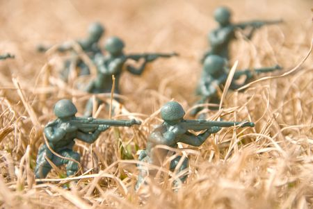 A group of toy soldiers on maneuvers.