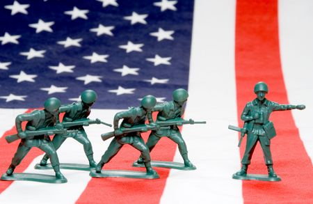 A group of toy soldiers on an American flag.