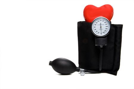 sphygmonanometer: A red heart and a medical blood pressure Sphygmomanometer.
