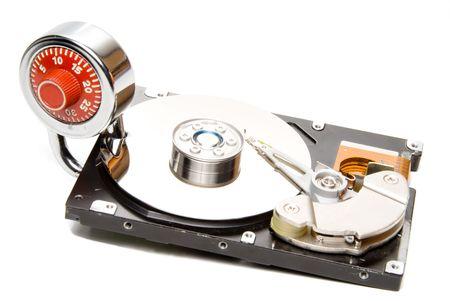 harddrive: A combination padlock on a computer hard drive.