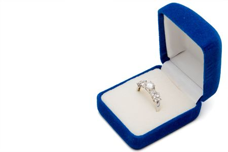 diamond stones: A wedding ring in a jewelers box.