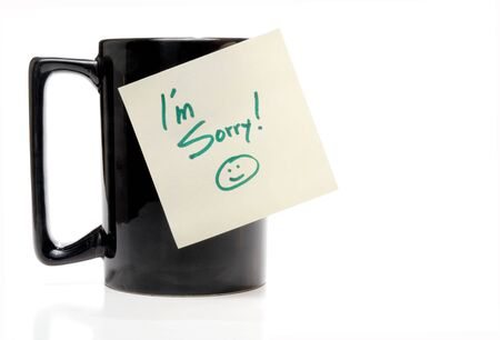 A coffee mug with an Im Sorry note. Stock Photo
