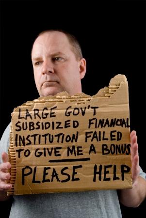 wirtschaftskrise: Ein Banker betteln w�hrend einer wirtschaftlichen Krise.