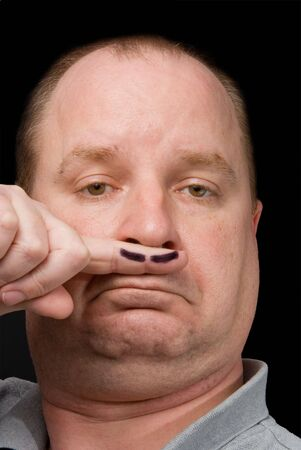 artificial hair: A man sporting a fake moustache on his finger. Stock Photo