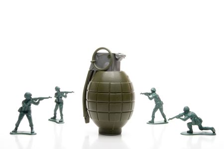 wmd: Several toy soldiers surrounding a hand grenade.