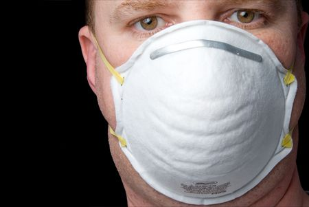 personal protective equipment: An inexpensive industrial respirator personal protective equipment. Stock Photo
