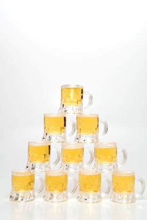 A set of Beer Mugs set up in a pyramid. photo