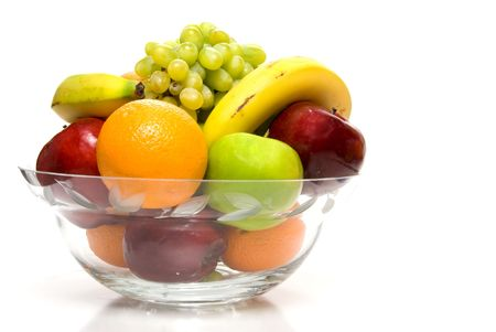 fruit: Assorted fruit in a large crystal bowl.