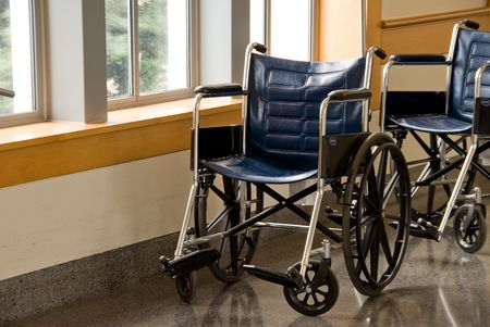 Wheel chairs parked in the corridor of a hospital. Stock Photo - 4718995