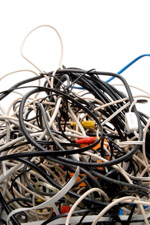 cable tangle: A mess of jumbled up tangled electronic wires.