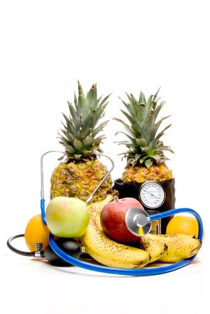 cuff: A bunch of healthy fruit getting a medical examination. Stock Photo