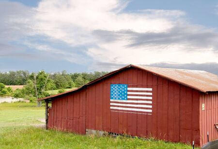 america countryside: An American flag painted on a barn. Stock Photo