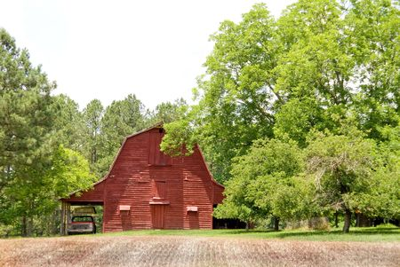 old red barn: An old red barn in a rural contryside setting.