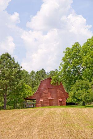 An old rural barn beside a farm field. Stock Photo - 5022734