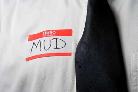 A name tag saying hello my name is mud.