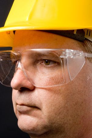 protective: A man with a hard hat wearing safety glasses.