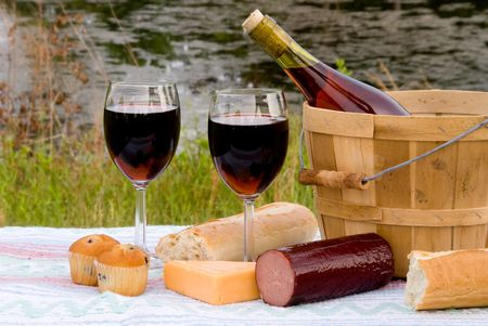 A wine and cheese picnic in the country.