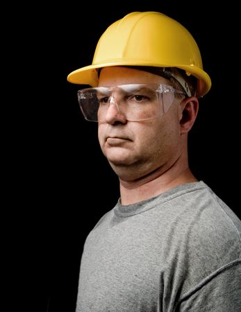 A man wearing Safety Glasses and a Hard Hat photo