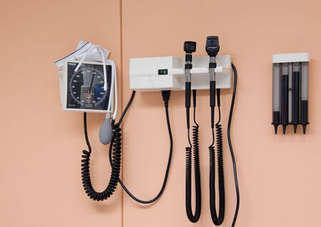 opthalmascope: A medical Otoscope and Sphygmonanometer in a doctors office. Stock Photo