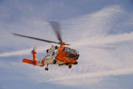 coast guard: A white and orange Coast Guard Jayhawk Rescue Helicopter