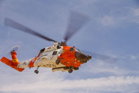 find us: A white and orange Coast Guard Jayhawk Rescue Helicopter