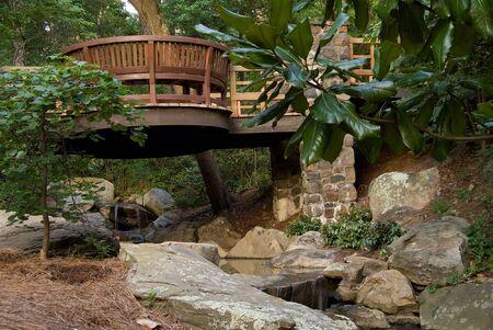 A Japanese Style Bridge in a botanical garden. Stock Photo - 5140073