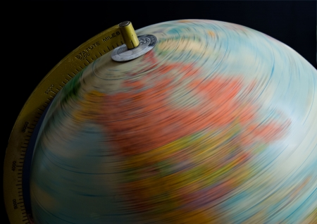 An educational globe spinning on its axis. Stock Photo