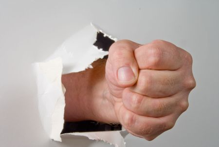 A human fist punching through a wall.