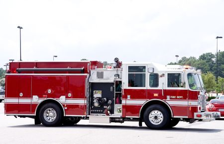 engine fire: An emergency services vehicle better known as a firetruck. Stock Photo