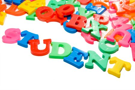 english letters: Magnetic letters spelling out the word Student.
